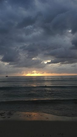 Nirvana on the Beach: Our first sunset.  Still gorgeous even with the clouds!