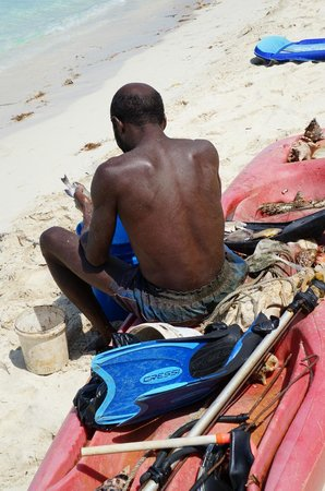Nirvana on the Beach: The local fisherman arrived every morning.  I purchased fresh conch and made salad!