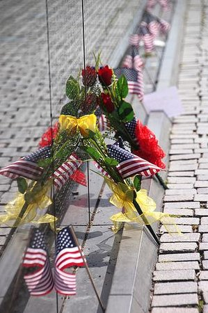 Flags and other items left at the Vietnam Veterans Memorial
