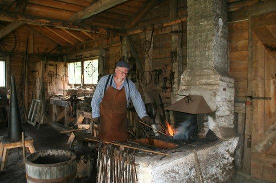 Highland Village Museum blacksmith hard at it.