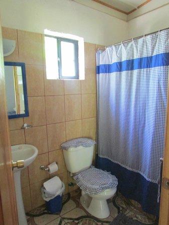 Residencial Tekena Inn: baño de la habitacion