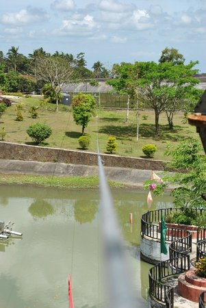 Chateau Royale Hotel Resort and Spa: View of the fishing lake from top of the zip line at Chateau Royale