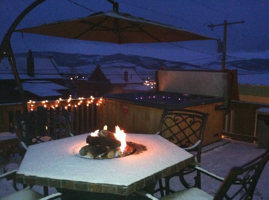The Sanctuary: Back deck with hot tub, BBQ and firepit table