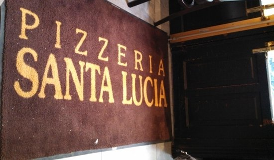 Santa Lucia : Pizzas tasted much like the mat looks.