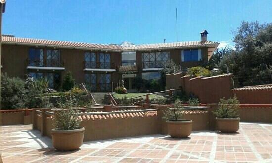 Casa Andina Premium Puno: patio interior del jardín. .