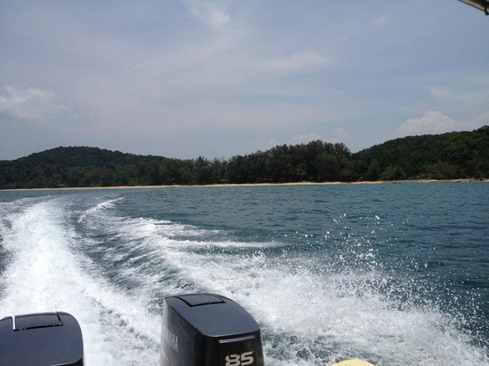 Sea Gypsy Village Resort & Dive Base: view of the island/resort from the boat