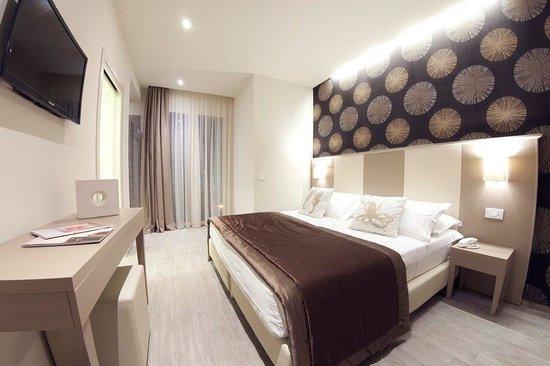 L'Hotel Rimini : Diverse le colorazioni delle stanze de L'Hotel