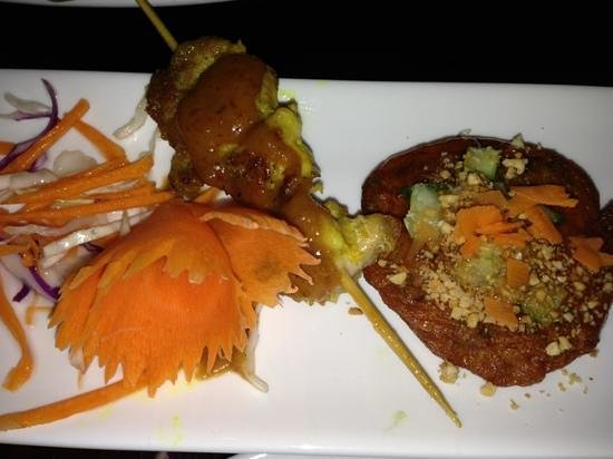 Rice Tapas: Mixed Entree of Chicken Satay, Fish Cake and Spring Roll.
