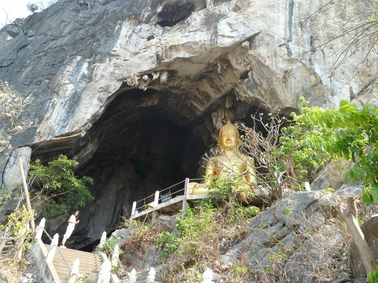 The Buddha statue at the entrance to Erawan Cave