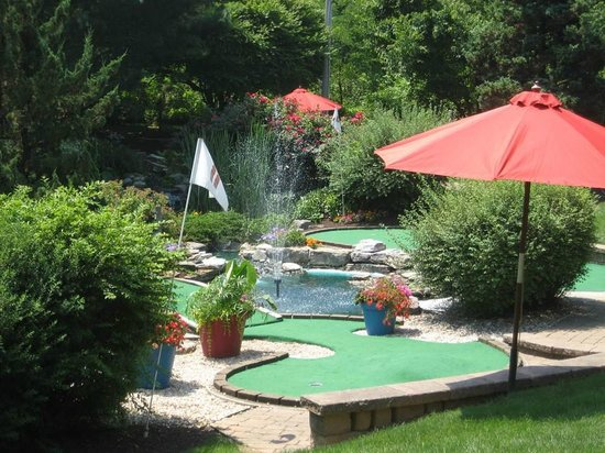 Challenge Family Fun Center: Water features, flowers and shade on our mini-golf course