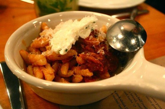 Two Restaurant & Bar: Homemade ricotta cavatelli, pork neck and sausage gravy, herb whipped ricotta, WI parmesan