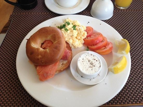 The Twenty One : One of the breakfast choices, smoked salmon bagel with cream cheese, scrambled eggs and tomatoes