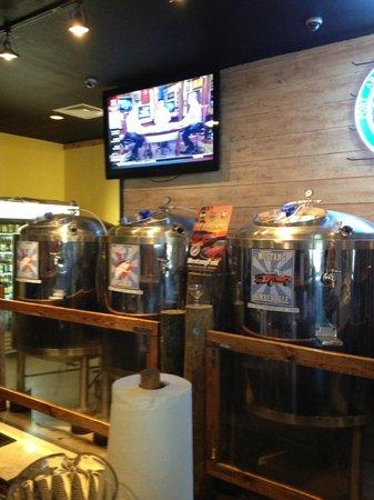 Port Aransas Brewing Company: Brewing tanks behind bar.  Very uncomfortable bar stools.
