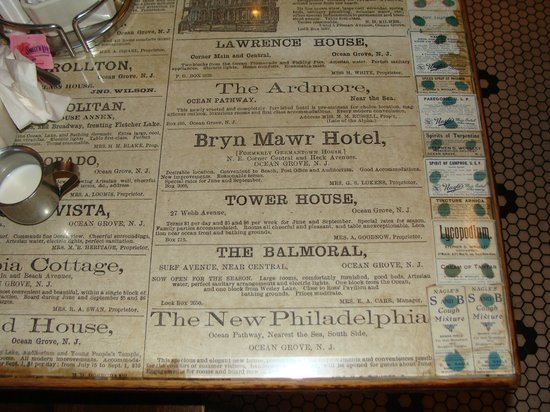 Nagle's Apothecary Cafe : Tabletops have old newspapers under the glass, found in the basement during remodeling.