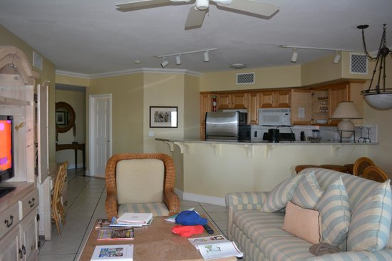 The Sands at Grace Bay: kitchen, entry, living room, table just to back of couch, from patio door looking in.