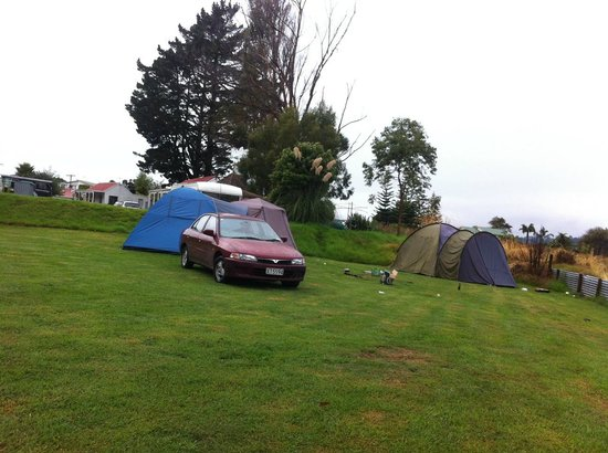 Whitianga Campground : One of the three cars of the drunk campers with their empty beer boxes loitering the ground.