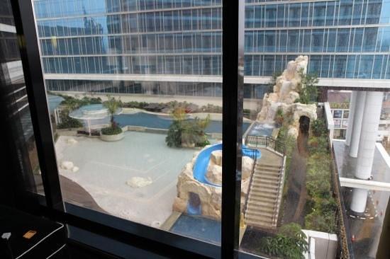 The Trans Luxury Hotel Bandung: room window overlooking the pool area