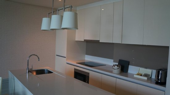 Oriental Residence Bangkok: Kitchen With Washer And Dryer