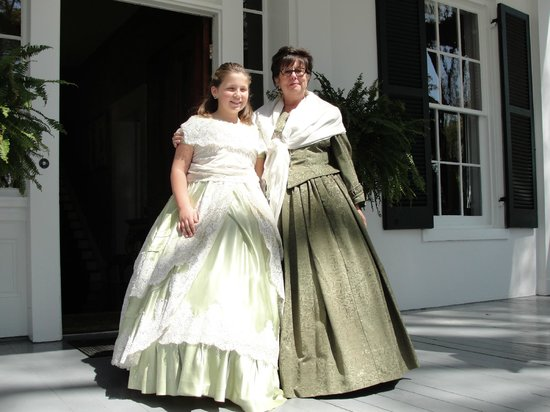 Twins Oaks Bed and Breakfast : Regina, owner, and my granddaughter on the front porch ready to recieve pilgrimage guests