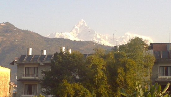 Sacred Valley Inn Pokhara: The grand snow clad MachaPuchare from SVIP terrace.