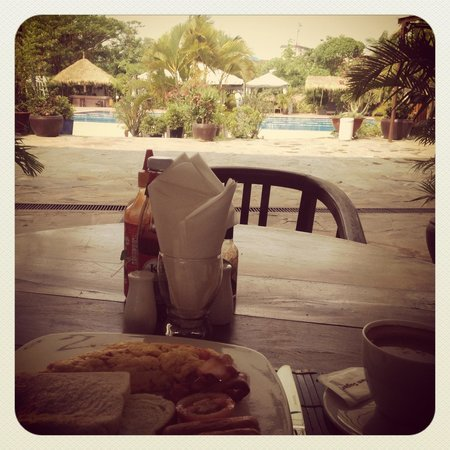 CCC Hotel : Free breakfast by the pool. Eggs on toast, grilled tomato, bacon, sausages, a coffee and a fruit