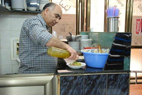 Lina Restaurant: Humus master at work