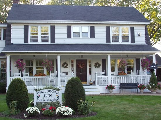 Front Porch With White Wooden Rockers Picture Of Dutch Colonial