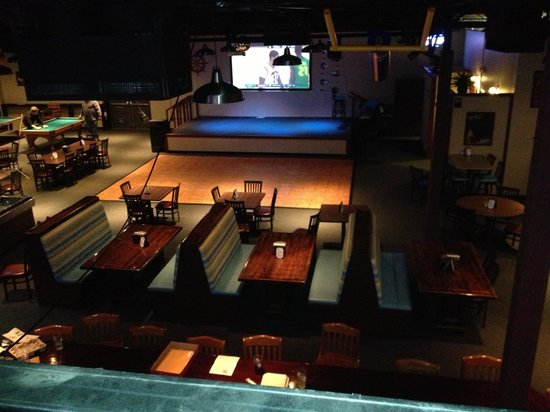Riptides sports bar: Huge stage and dance floor with two pool tables