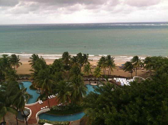 El San Juan Resort & Casino, A Hilton Hotel: A view of the great pools and beach from the roof of the main tower
