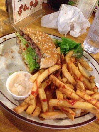 Burgers Restaurant: Half eaten buffalo quarter pounder...