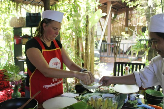 Khmer Dining Cuisine: Chef is assisting residnent how to prepare and cook Khmer Food