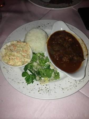 Carib Grill: curry goat and rice