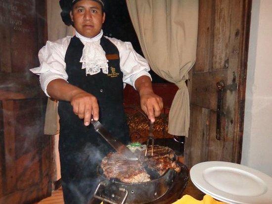 Casa Escobar Restaurant : Our really nice waiter serving our steak