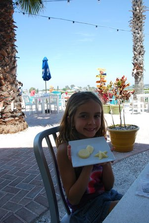 Seabreeze Island Grill and Raw Bar: Our 8 year old daughter, Marissa - showing off the shaped butters
