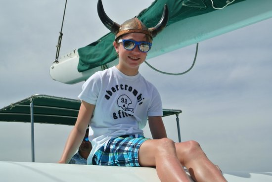 La Princesa Catamaran: Son enjoying the day and the many hats aboard!