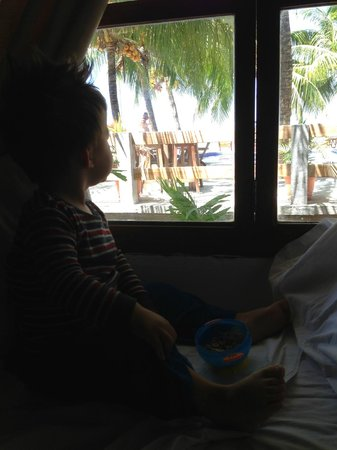 Hotel Anamar: My little boy, looking out the window at the pool and beach.