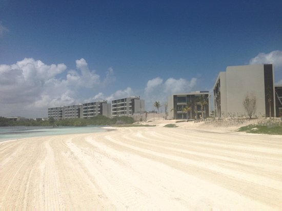 NIZUC Resort and Spa: beach looking toward mangrove/towers