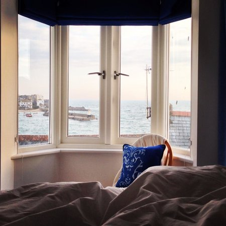 Trevose Harbour House: View from bed to the harbour