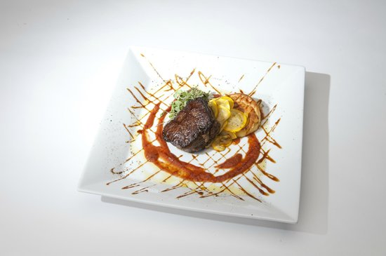 Osprey Point Restaurant : Filet Mignon with Summer Squash, Tomato Jus, and Cheve & Roasted Garlic Souffle