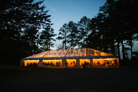 Osprey Point Restaurant: Night photo of a tented wedding reception