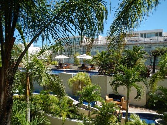 Porto Playa Condo Hotel & Beachclub: View from 2nd floor unit of gardens, pool area