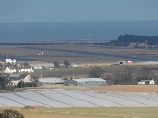 St Andrews Country Lodges: Leuchars air base can be seen from the cabins (this is zoomed in!)