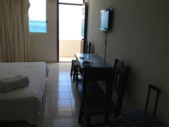 hotel hacienda morelos, cama y vista al balcón