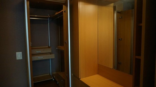 Brown Suites Residence: A huge wardrobe and makeup area that are perfect for ladies I guess