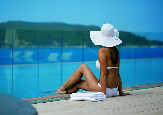 Queen of Montenegro: Girl by the pool