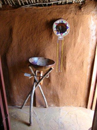 Muteleu Maasai Traditional Village: A private bathroom at the rear of each manyatta.