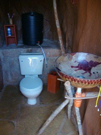 Muteleu Maasai Traditional Village: A toilet, sink and shower offer maximum privacy in each manyatta.