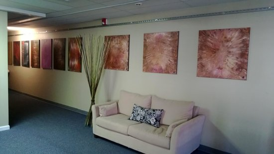 Milan Day Spa on Broughton: Gallery Wall in Waiting Area