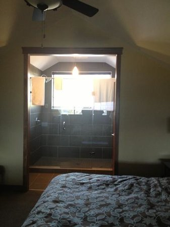 Bighorn Meadows Resort: The massive shower with a view from the 1BR loft.  Not private for a family stay but we gave the