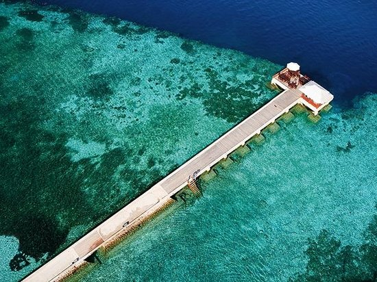 Wakatobi Dive Resort: Wakatobi's jetty and surrounding shallow reef at the drop off